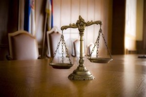14054798-symbol-of-law-and-justice-in-the-empty-courtroom-law-and-justice-concept